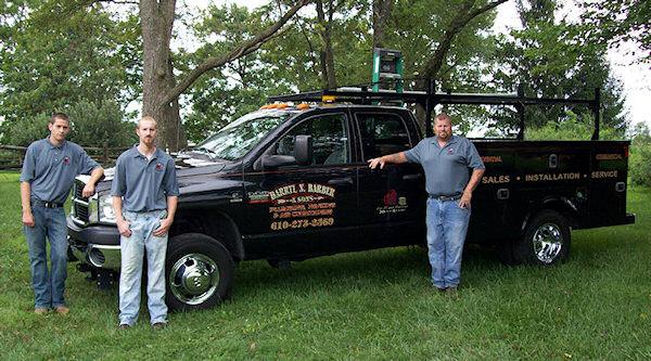 Darryl Barber plumbing & HVAC team standing by a work truck.